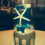Beach Themed Colored Water with Floating Candle