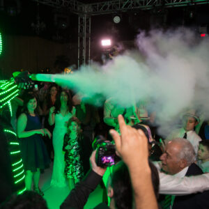 LED robot suit man blasts CO2 bursts over crowd