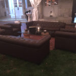 Brown Tufted Leather lounge furniture, Wine Cork Coffee Table, and Silver Metal Lantern