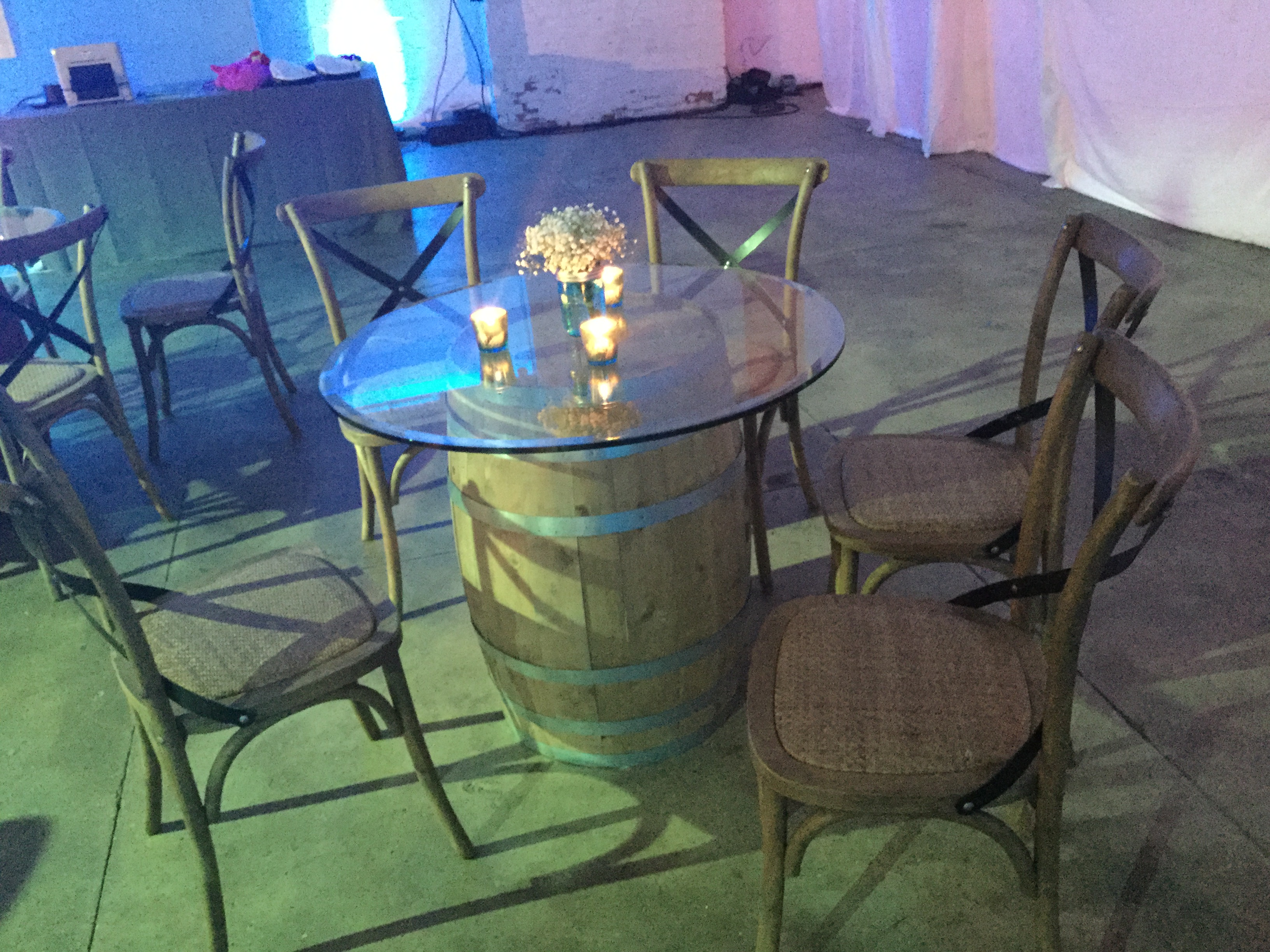 wine-barrel-table-and-wooden-chairs